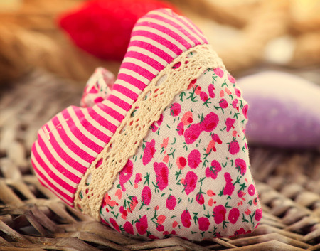 Valentine s Day  Handmade fabric heart over wood background photo