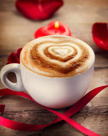 Valentine s Day Coffee or Cappuccino with heart on foam photo