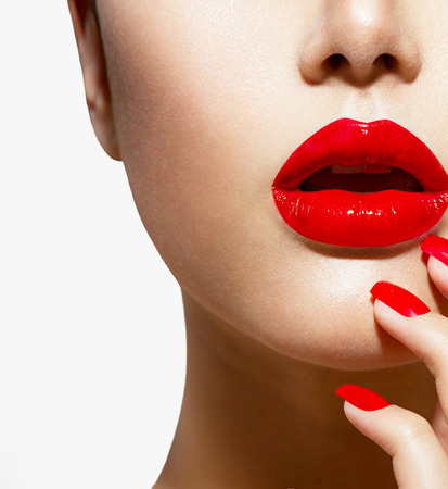 red lips: Red Sexy Lips and Nails closeup  Manicure and Makeup Stock Photo