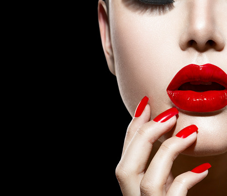 lip kiss: Red Sexy Lips and Nails closeup  Manicure and Makeup Stock Photo