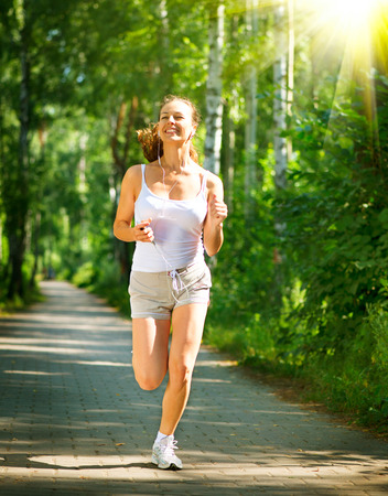 Running Woman  Outdoor Workout in a Park  Full Length Portrait  Stock Photo