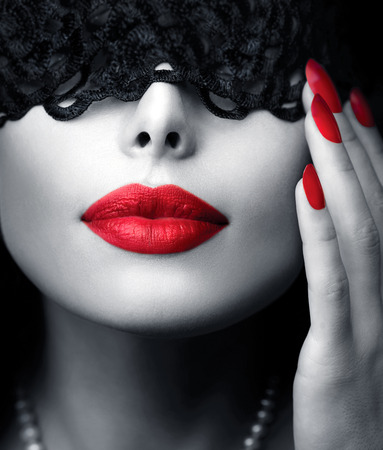 Beautiful Woman with Black Lace Mask over her Eyes Imagens