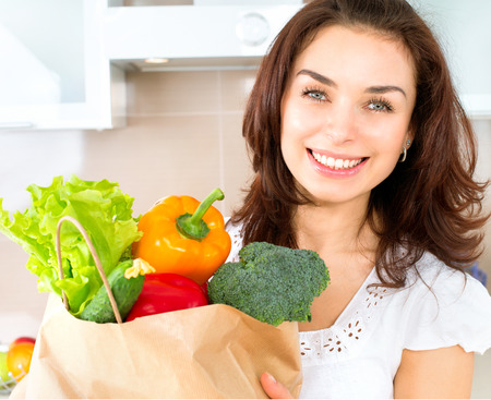 Happy Young Woman with Vegetables in Shopping Bag  Diet Concept  photo