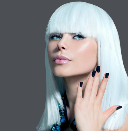 Vogue Style Model Portrait  Girl with White Hair and Black Nails photo