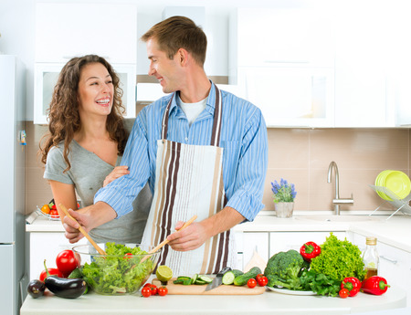 woman cooking: Happy Couple Cooking Together  Dieting  Healthy Food