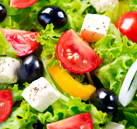 Greek Salad closeup with Feta Cheese, Tomatoes and Olives photo
