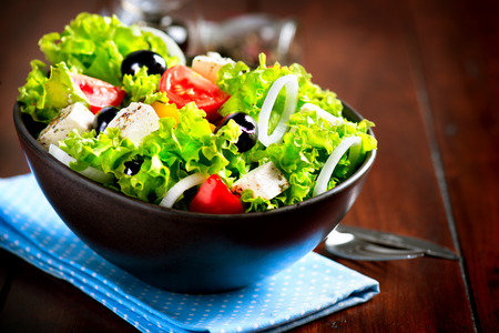 Greek Salad Bowl with Feta Cheese, Tomatoes and Olives photo