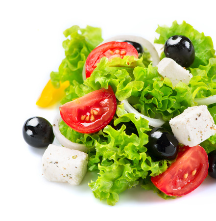 food on white: Mediterranean Salad  Greek Salad isolated on a White Background Stock Photo