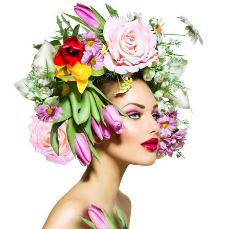 stile: Primavera di bellezza Ragazza con i fiori Hair Style Archivio Fotografico