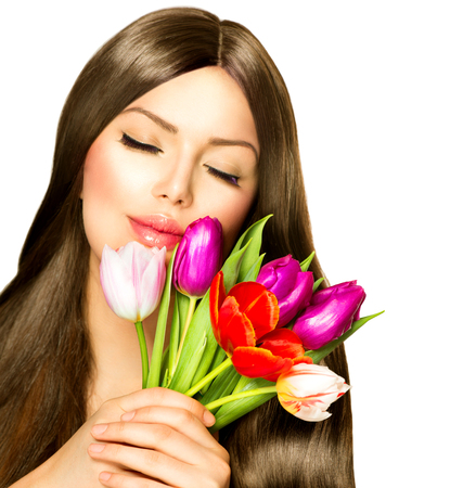 Beauty Woman with Spring Bouquet of Tulip Flowers photo
