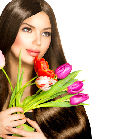 girl models: Beauty Woman with Spring Bouquet of Tulip Flowers