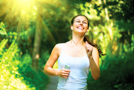 ladies: Running woman  Outdoor Workout in a Park Stock Photo