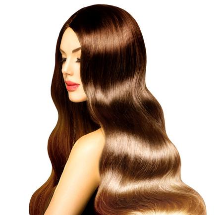 健康な長いウェーブのかかった髪と完璧なメイクと美容モデルの女の子 写真素材