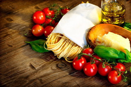 Pasta  Italian homemade spaghetti with parmesan and tomatoes Stock Photo