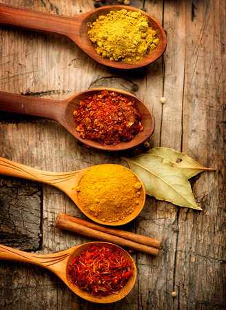 Various spices and herbs over wooden background Reklamní fotografie