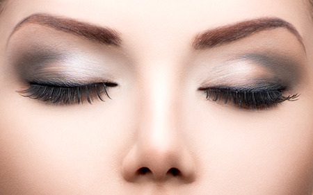 eyeshadow: Beauty eyes makeup closeup  Long eyelashes, perfect skin