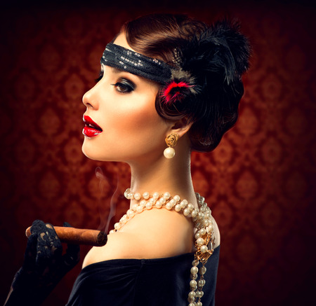 style: Retro Woman Portrait  Vintage Styled Girl With Cigar Stock Photo
