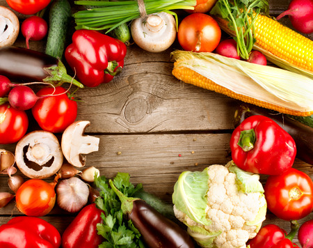 organic background: Healthy Organic Vegetables on a Wooden Background Stock Photo