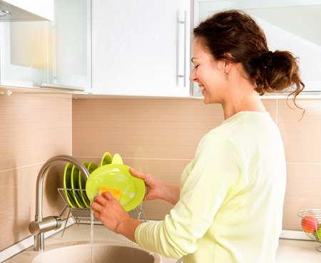 Woman Washing Dishes  Kitchen Stock Photo - 27091191