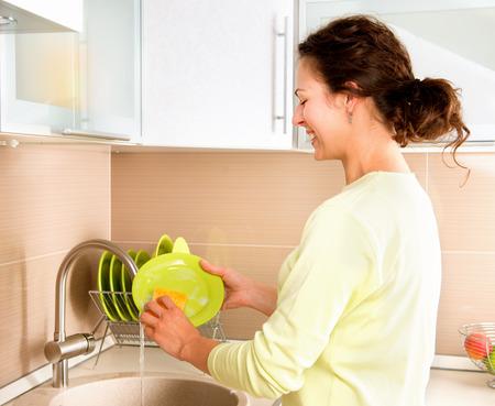 Woman Washing Dishes  Kitchen Stock Photo - 27091191