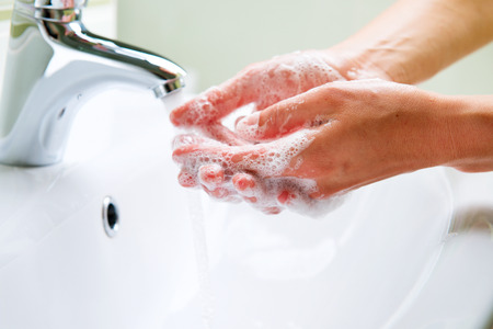 female hand: Washing Hands with Soap