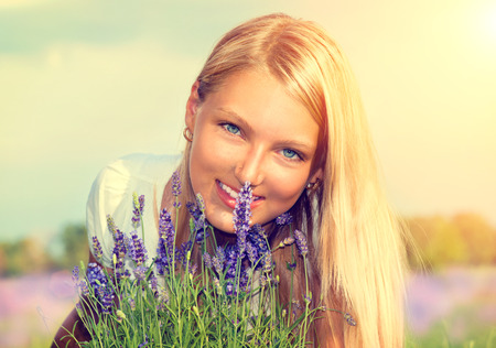 Beautiful Girl with Flowers in Lavender Field photo