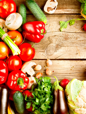 vegetarian: Healthy Organic Vegetables on a Wooden Background Stock Photo
