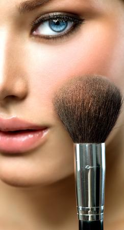 makeup face: Makeup applying  Beautiful fashion model girl face closeup Stock Photo