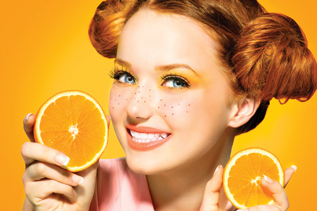 freckles: Beauty model girl with juicy oranges  Freckles