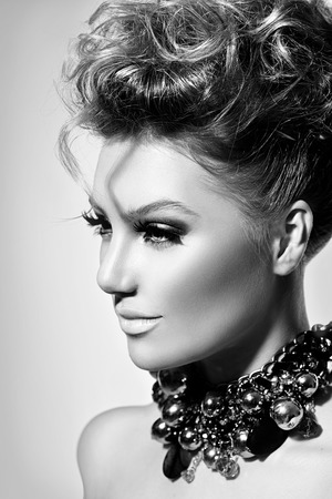 Beautiful model girl with perfect fashion makeup and hairstyle photo