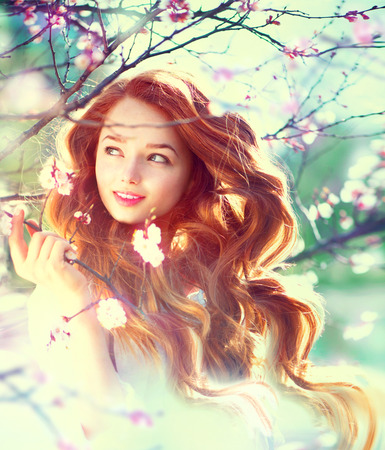 ginger health: Spring beauty girl with long red blowing hair outdoors