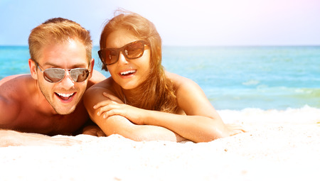 beach summer: Happy Couple in Sunglasses Having Fun on the Beach  Summer