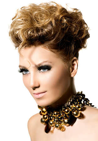style: Beautiful model girl with perfect fashion makeup and hair style