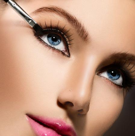 Makeup applying closeup  Eyeliner  Cosmetic eyeshadows