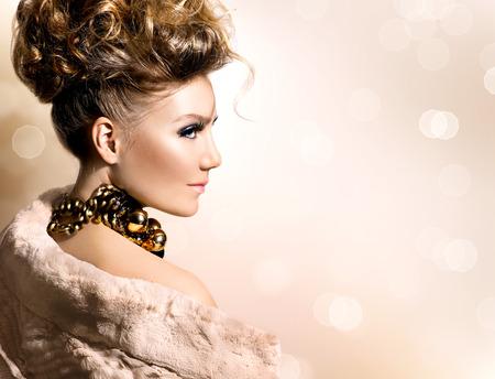Beautiful model girl in luxury fur coat