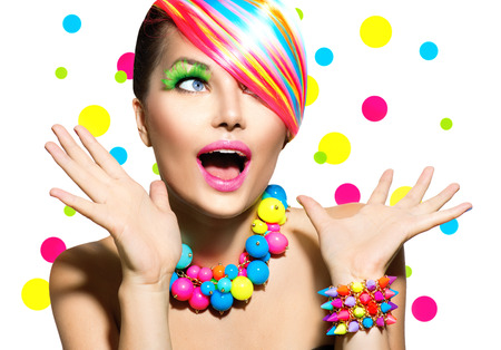 Beauty Portrait with Colorful Makeup Manicure and Hairstyle photo