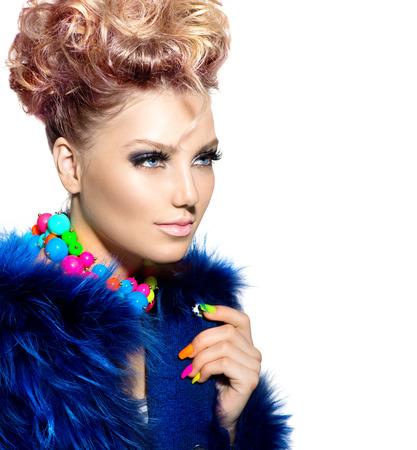 Beauty woman portrait in fashion blue fur coat photo
