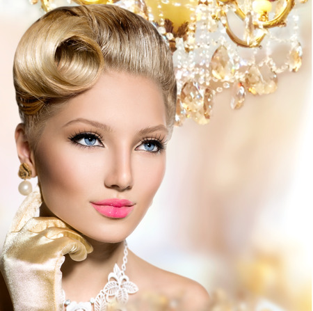 earring: Vintage styled girl with perfect make up and hairstyle