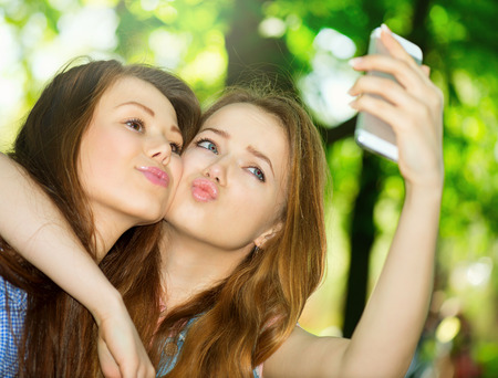 Teen friends taking photos with a smartphone  Selfie