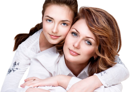daughter: Close-up Portrait of Mother and her Teenage Daughter Stock Photo