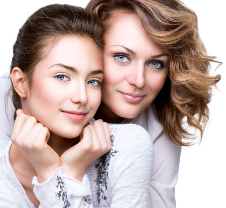 Attractive happy mother and smiling teenage daughter photo