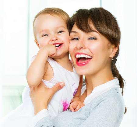 Mother and baby kissing and hugging at home Stock Photo