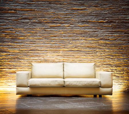 モダンなスタイルのインテリア デザインのベージュ革のソファ