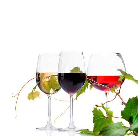 Three glasses of wine isolated on white background Imagens