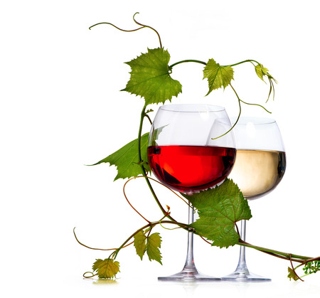 Two glasses of red and white wine decorated with grape leaves Stok Fotoğraf