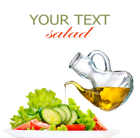 Healthy vegetable salad with olive oil dressing over white Imagens