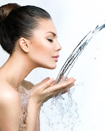 beautiful model: Beautiful model woman with splashes of water in her hands