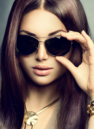 model: Beauty model girl with long brown hair wearing sunglasses