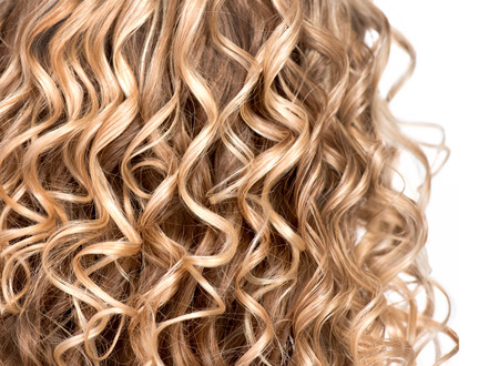 Wavy curly blonde hair closeup  Texture of permed hair 版權商用圖片