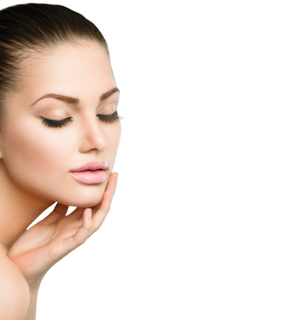 face: Beauty Spa Woman Portrait  Beautiful Girl Touching her Face Stock Photo